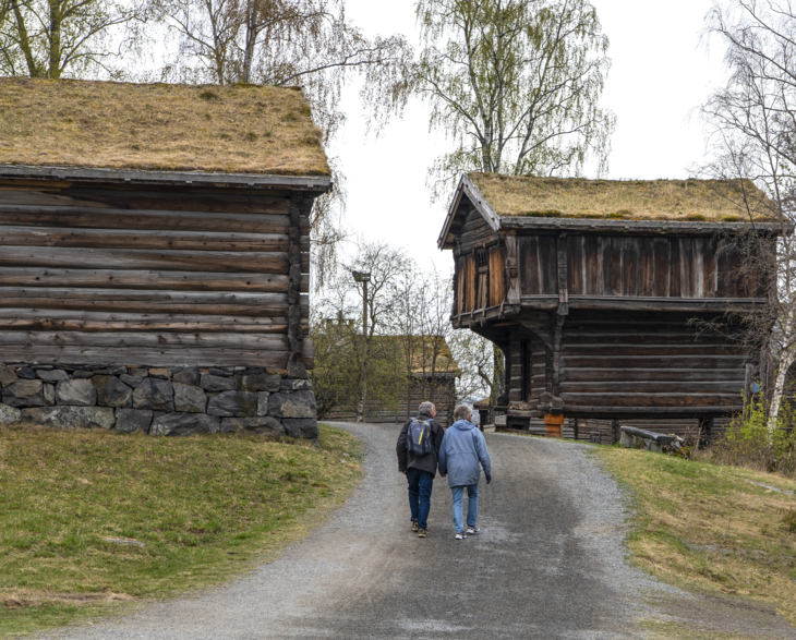 Walking couple holding hands at Maihaugen open air-museum.