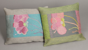 Pillows in tapestry with flowers.