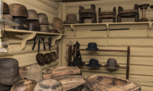 Hatter's workshop with scissors, shapes in wood, other euipment and felt hats. In the open-air museum Maihaugen at Lillehammer.