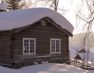The old timber school building at Maihaugen at winter time.