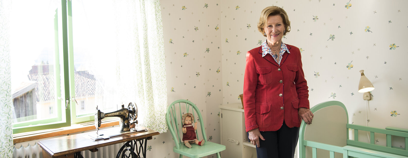 Queen Sonja in the bedroom she had as a child in her childhood home at Maihaugen open air-museum in Lillehammer.